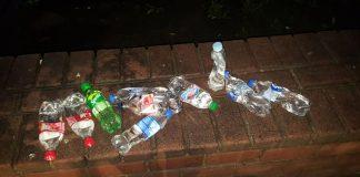 Франківські муніципали вилили 10 пляшок сурогату ФОТО